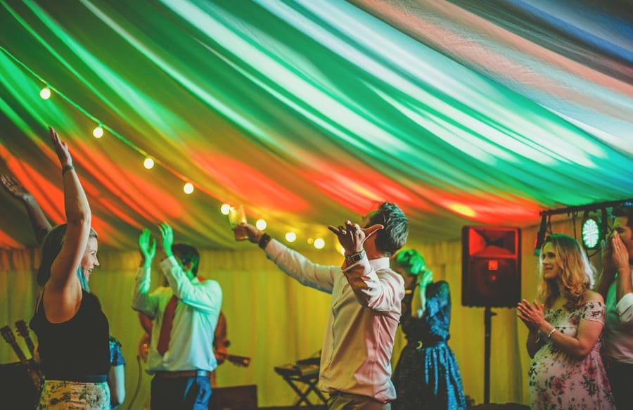 A wedding guest dancing in the marquee