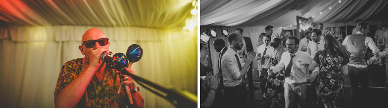 A man performs a song for the wedding guests in the marquee