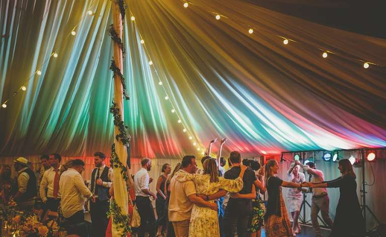 The wedding party dancing on the dancefloor