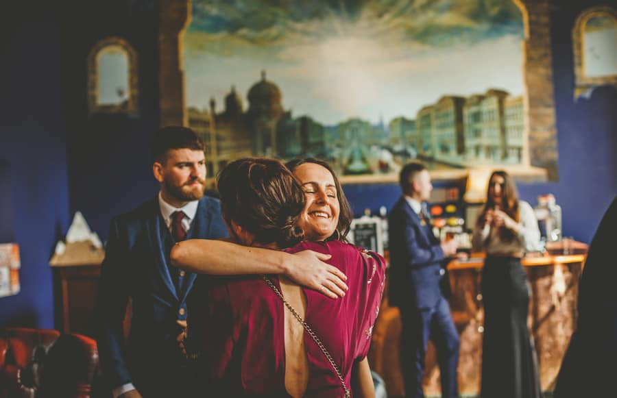 A wedding guest puts her arm around a friend at Kings Weston House in Bristol