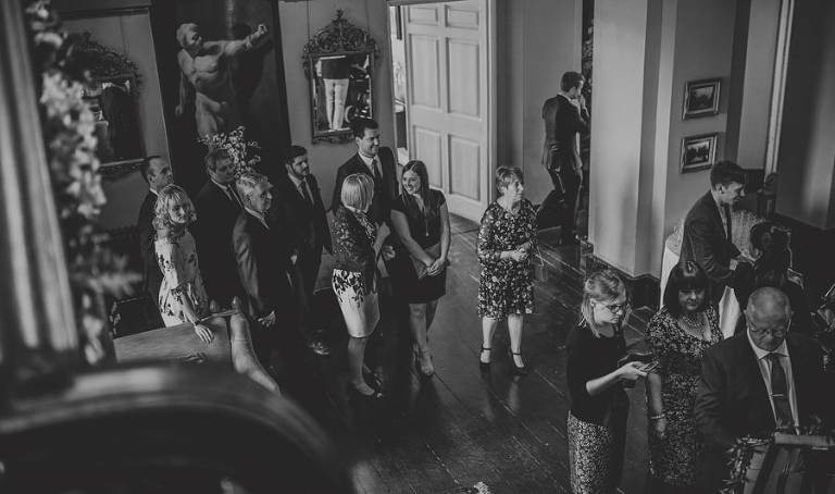 Wedding guests start to walk across Kings Weston House