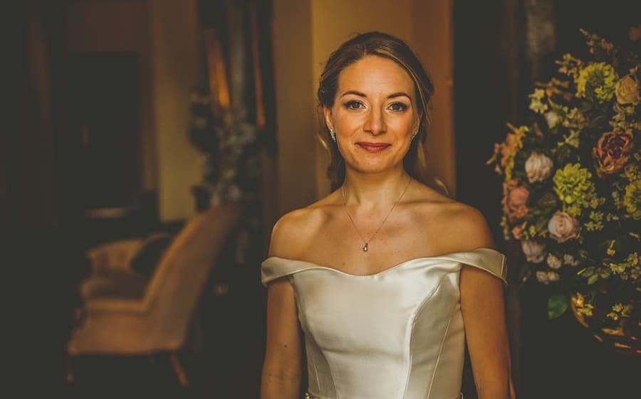 The bride poses for a photograph at Kings Weston House in Bristol
