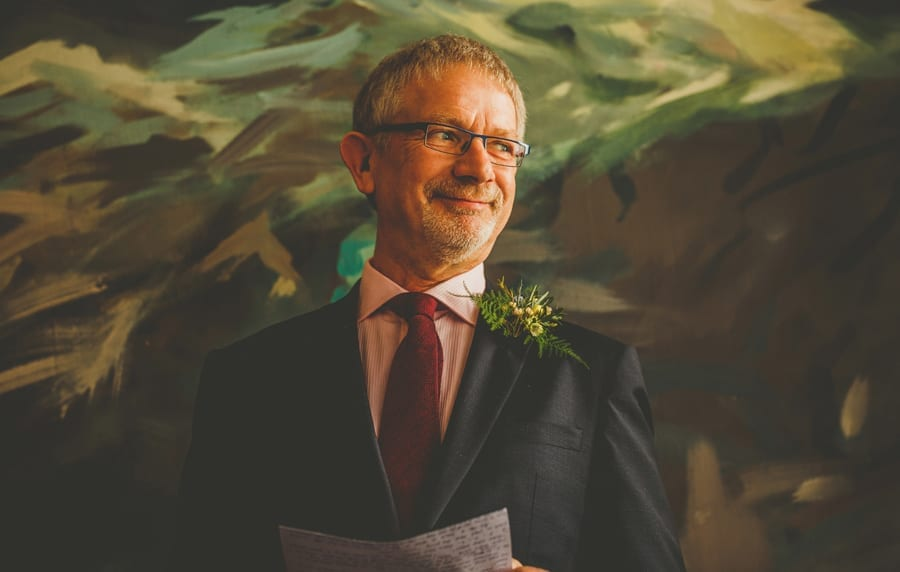 The brides father smiles during his wedding speech