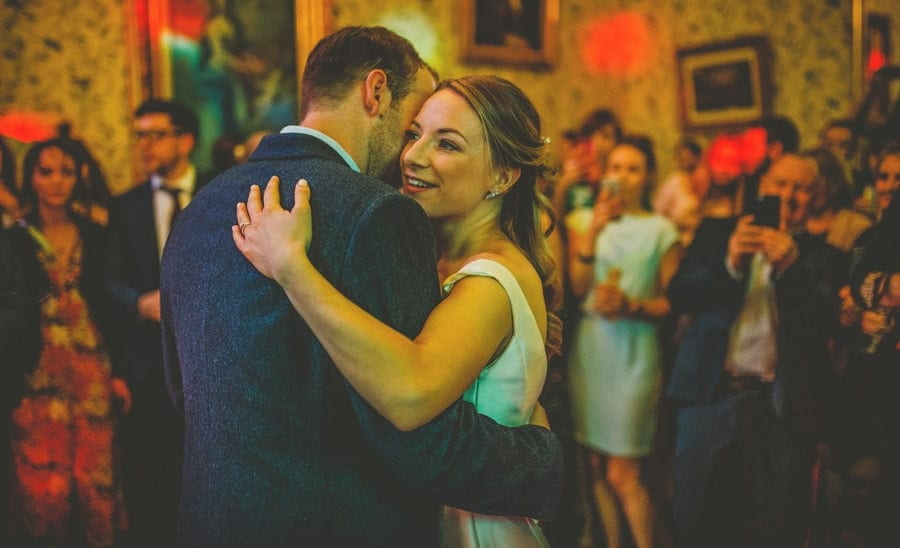 The bride and groom dance together on the dancefloor at Kings Weston House