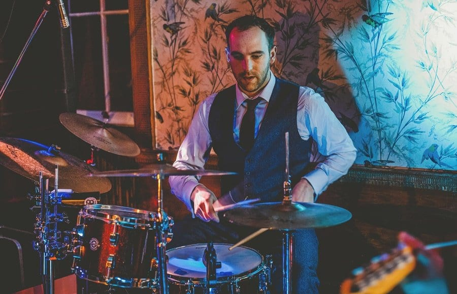 The groom plays drums at Kings Weston House