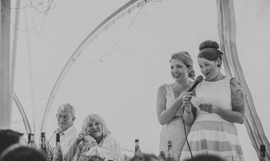 The wedding couple deliver their speech in the marquee at Little Quarme Cottages