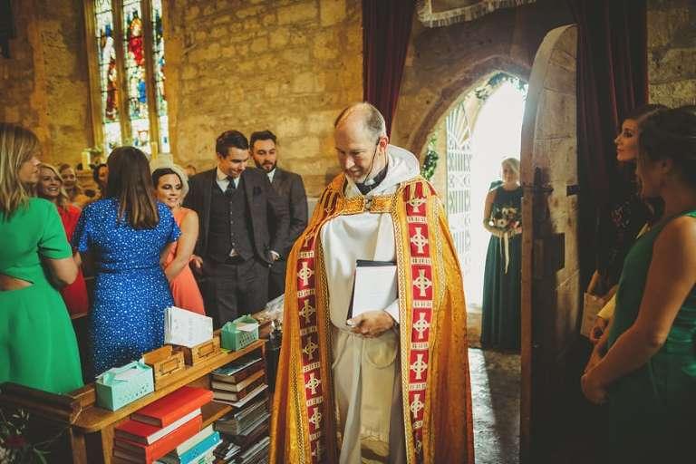 The vicar enters the Church