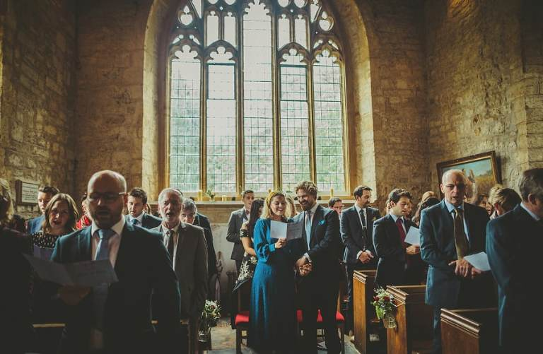 All the wedding guests stand in the Church and sing a hymn from the order of service