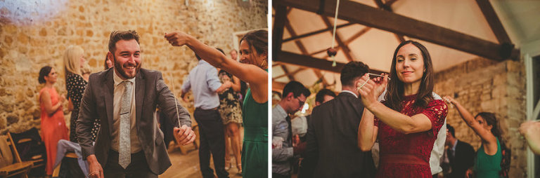 Wedding guests play conkers in the barn