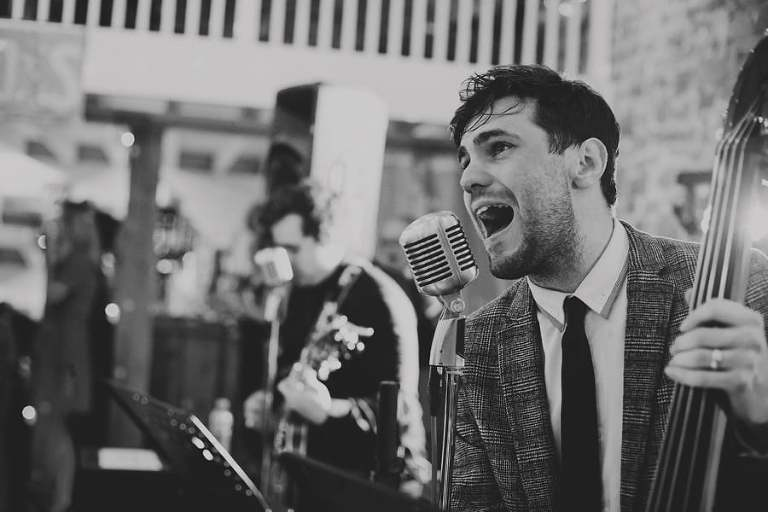 The singer of the wedding band performs a song