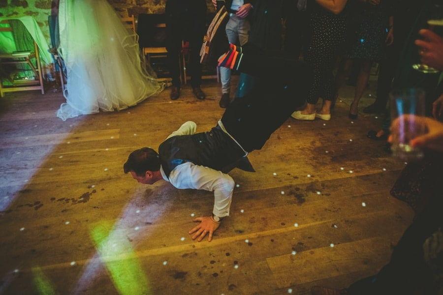 The groom throws himself onto the dancefloor