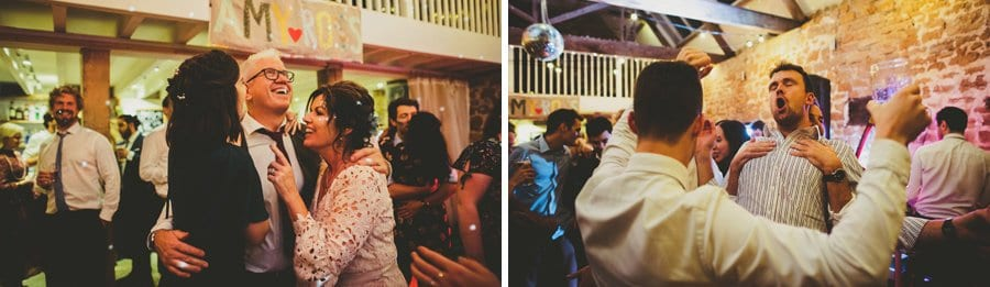 The bride's family share a joke together on the dancefloor