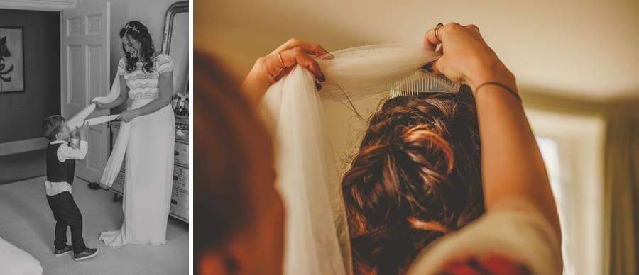 A bridesmaids places the veil over the brides head