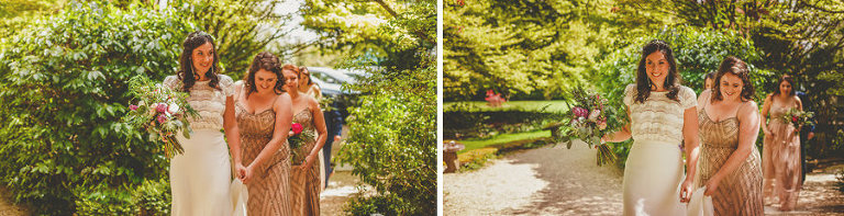 The bride and her bridesmaids walks through the gardens and towards the outdoor wedding ceremony