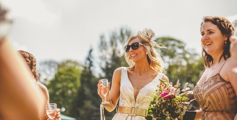 A wedding guest greets the bride and groom