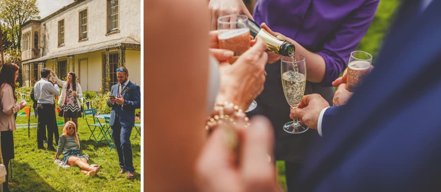 A member of staff pours champagne into flutes for the wedding guests