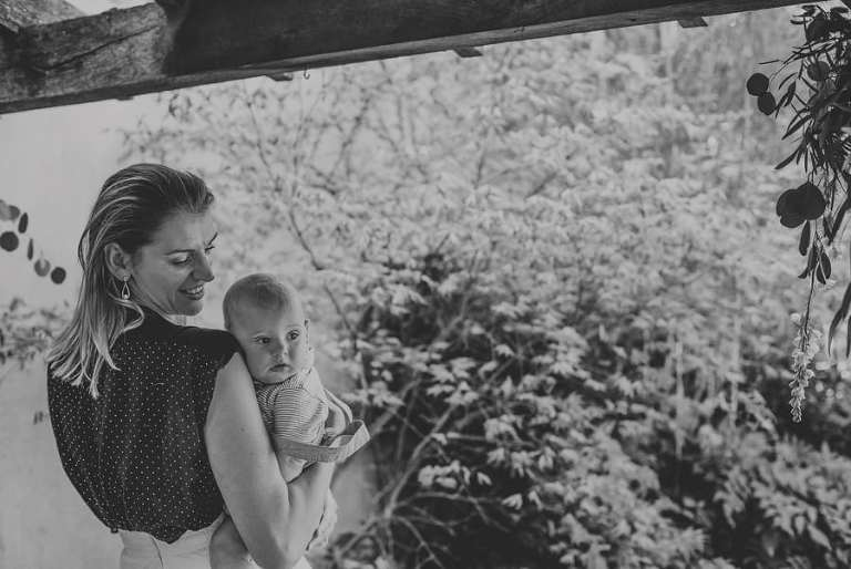A wedding guest holds her daughter in her arms