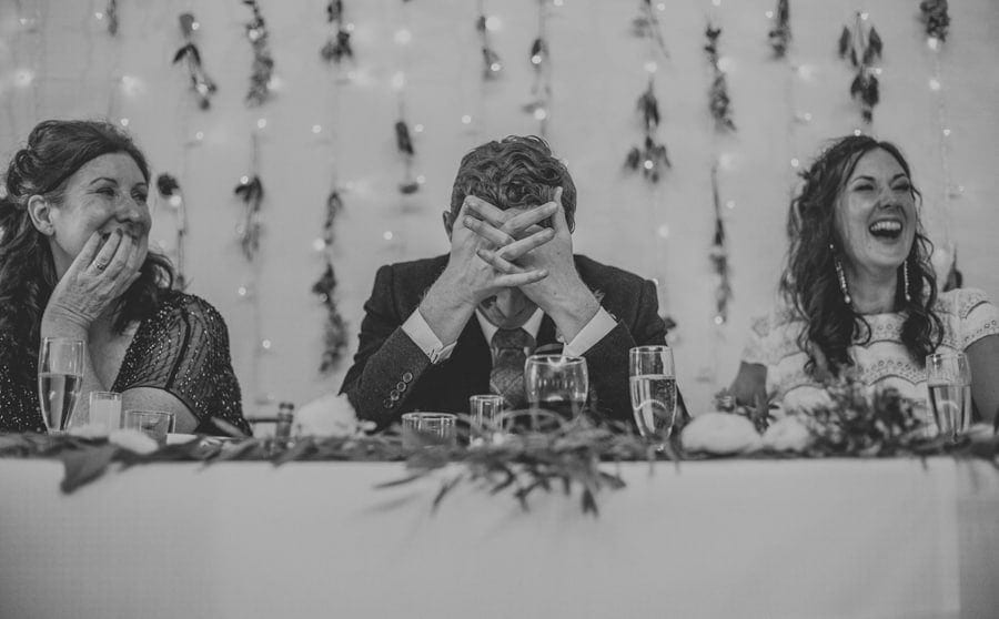 The groom puts his hands on his head