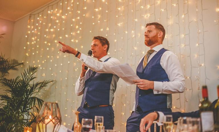 The best men deliver their speech to the wedding guests