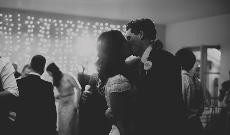 The bride and groom kiss on the dancefloor at the Matara Centre