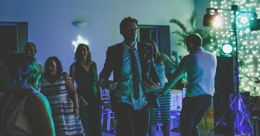 The groom walks along the dancefloor