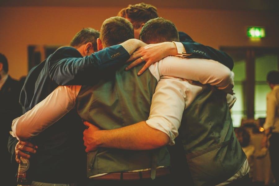 Men holding each other on the dancefloor
