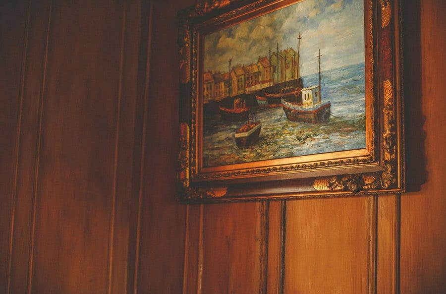 An oil painting hangs on a wall at Orchardleigh house in Frome, Somerset