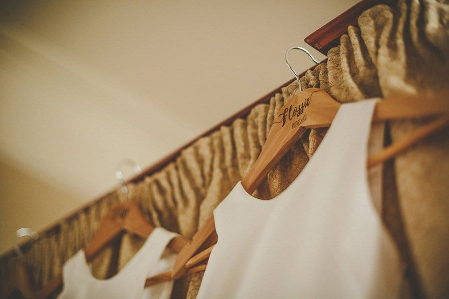 The bridesmaids dresses hang from the bed in the Master bedroom at Orchardleigh House