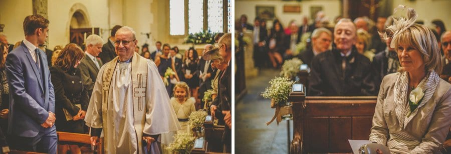 The vicar walks down the aisle of the Church