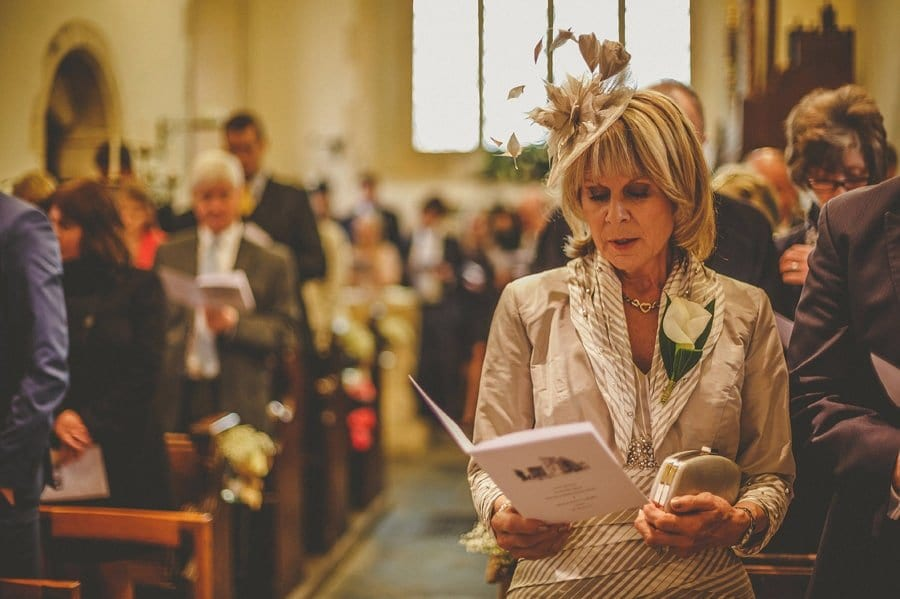 The brides mother sings a hymn in Church