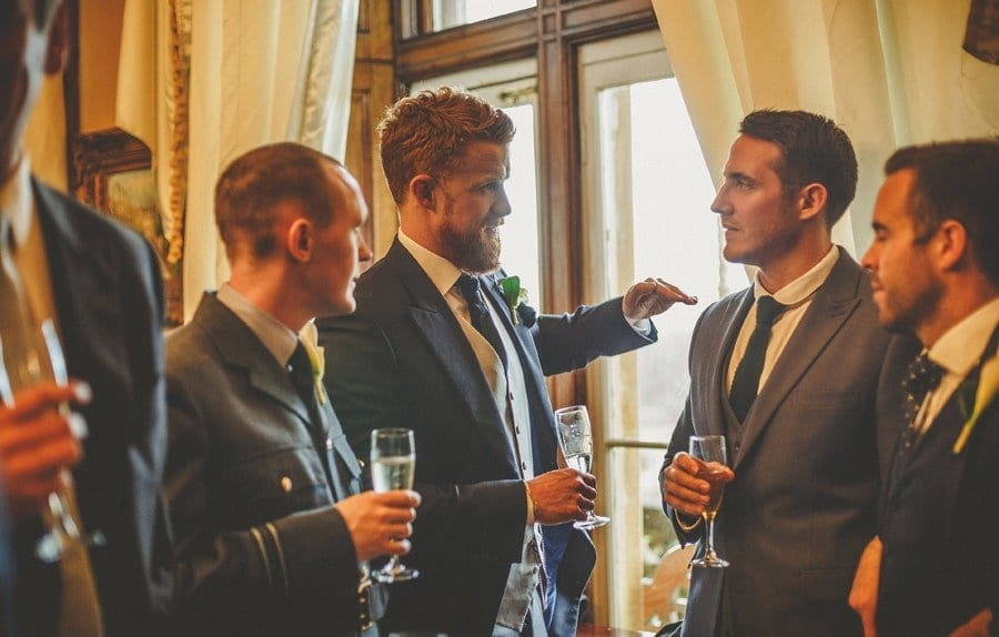 A wedding guest talking to one of the ushers