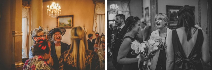 A wedding guest laughs with other wedding guests