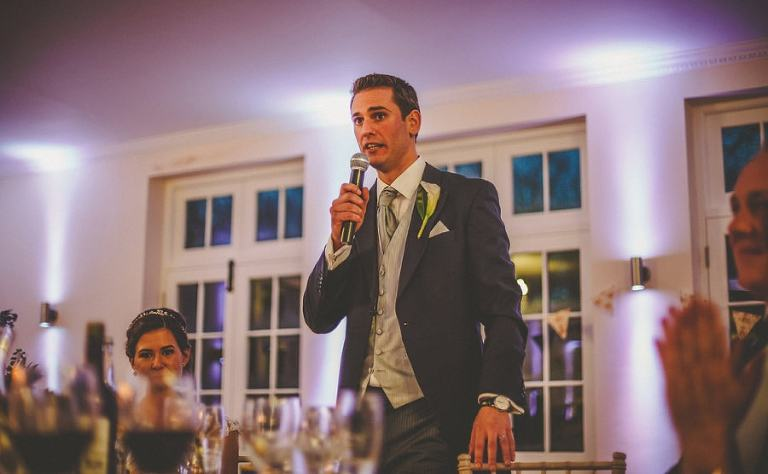 The groom delivers his speech in the Orangery