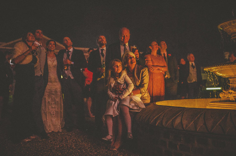 Wedding guests watch the firework display