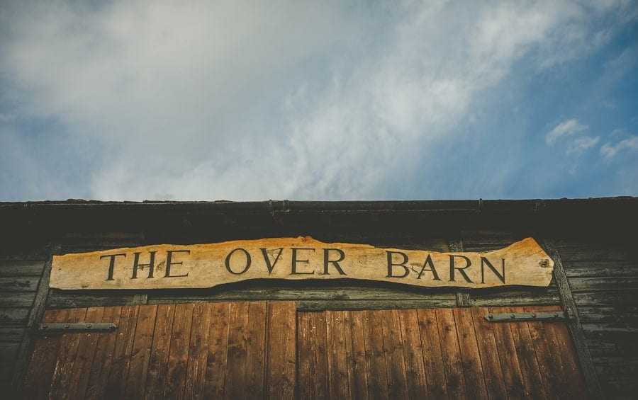 A wooden plaque that reads THE OVER BARN hangs above the barn doors