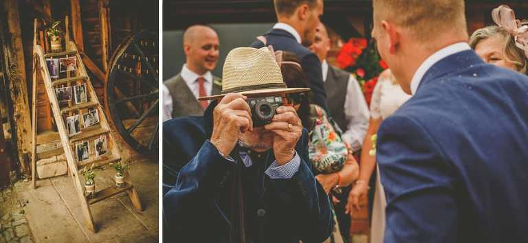 The grooms grandfather takes a photograph with an old film camera of his grandson