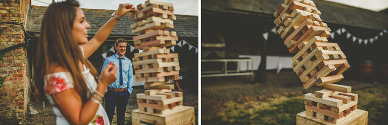 Two wedding guests play large Jenga together