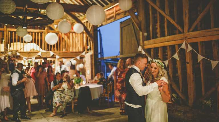 The bride and grooms first dance on the dancefloor at Over Barn