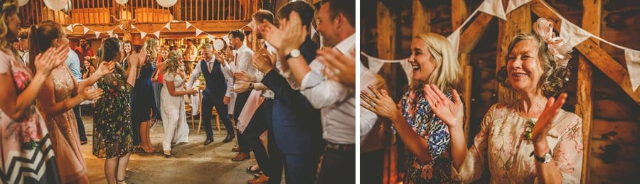 The bride and groom dancing at Over Barn while the wedding guests gather round