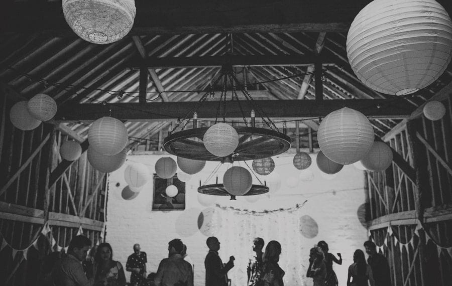 Wedding guests dancing at Over Barn in Gloucestershire