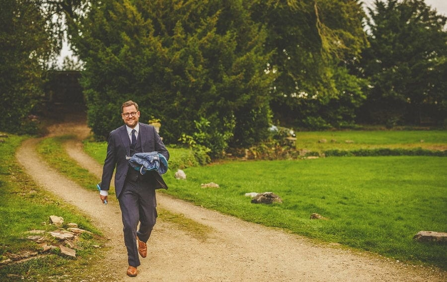 A family member of the bride arrives at the cottage