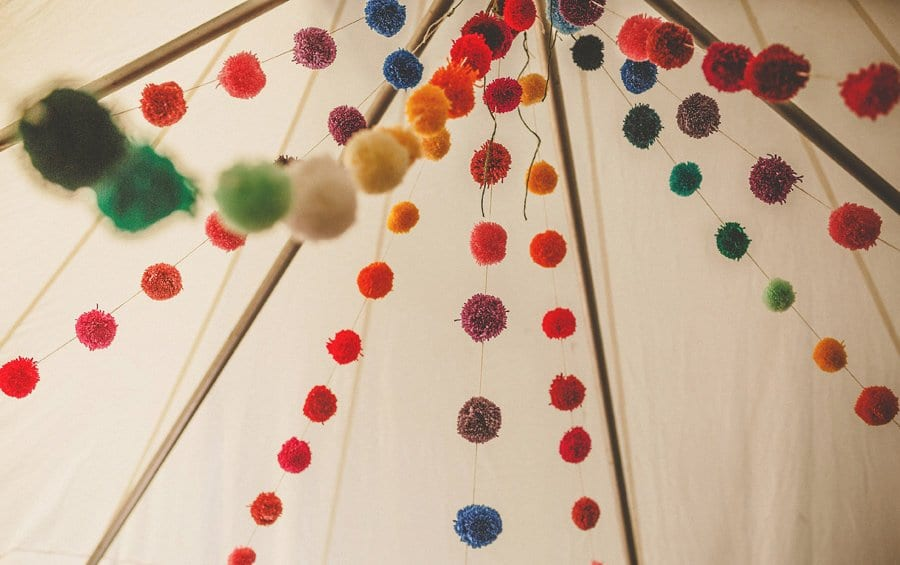 Wedding decorations hang from the ceiling of the marquee at Silk Mill Studios in Frome