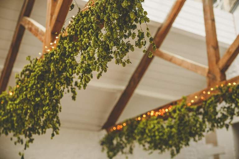 Flowers hang from the large wooden beams at Silk Mill Studios