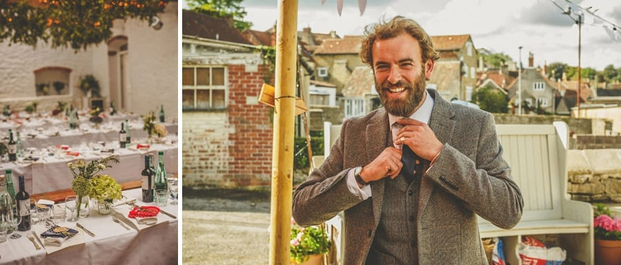 A wedding guest smiles and straightens his tie
