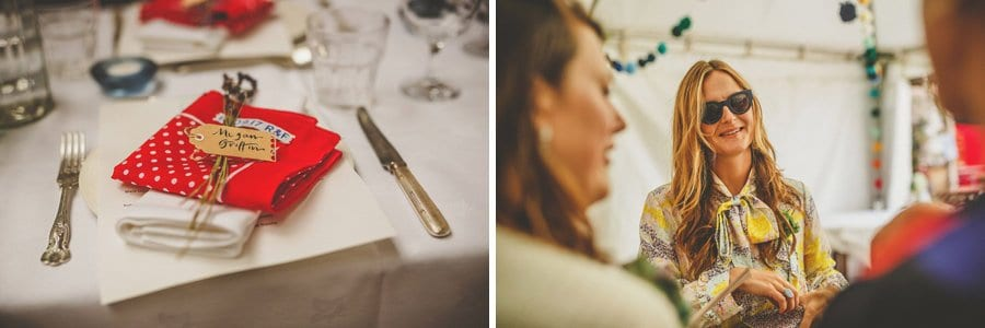 A wedding table is set and a wedding guest talks with friends