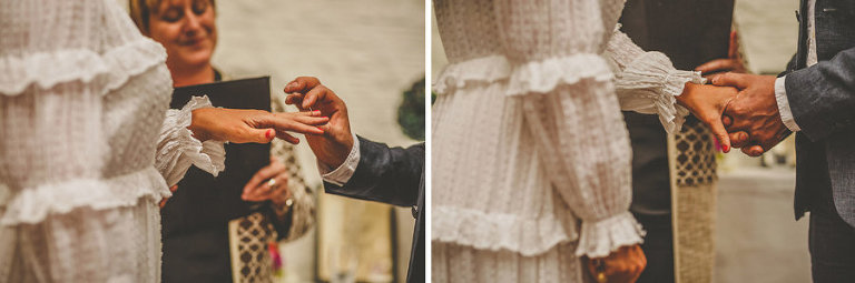 The bride and groom exchange rings during the wedding ceremony at Silk Mill Studios