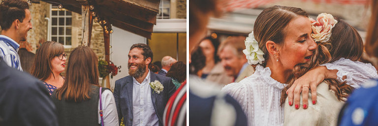 The bride and groom chat with friends and family in the courtyard at Silk Mill Studios in Frome