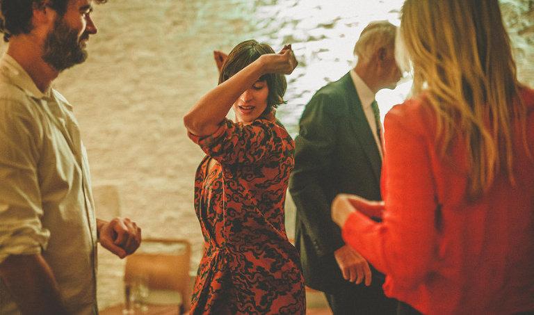 A wedding guest dancing at Silk Mill Studios