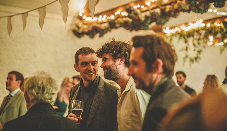 Wedding guests chat to each other on the dance floor
