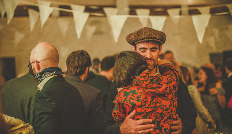 A wedding guest dancing with his wife on the dancefloor